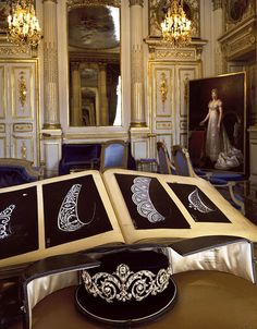 The Talhouet tiara, in it's original case at Chaumet's headquarters, beside a book of tiara patterns