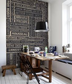 vintage wood signs make for a fabulous feature wall…and because of it's graphic nature, it adds an architectural quality to your space.