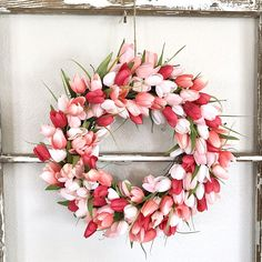 Spring tulip wreath made of brightly colored faux tulips on a grapevine wreath base. This stunning Spring tulip wreath is perfect for brightening up your front door for Valentine's Day through Easter and Mother's Day! It also makes a great gift! This wreath is approximately 18