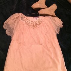 Beautiful pale pink lace top Stunning light pink blouse with see through lace short sleeves. Perfect for work, girls night out, or date night! Excellent used condition. NY Collection Tops Blouses