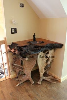 ... created using real antler sheds and live edge redwood burl slabs