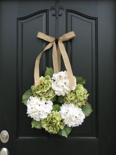 For wedding decor, using burlap and lace ribbons with white and green hydrangeas.  Make your own or here's an excellent designer at Etsy: Wreaths - Hydrangea Wreath -  Wreaths for All Seasons - Spring Hydrangeas - Spring Wreaths - Hydrangea Blooms. $70.00, via Etsy.