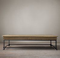1850s style french oak relief coffee table with elaborate wood carvings and molded edge paired with iron base, which adds more modern aesthetic to the 19th century inspired piece. $760 at restoration hardware.