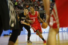 Houston Rockets' Isaiah Canaan (0), right, runs past Minnesota Timberwolves' Zack LaVine (8) during the first half of an NBA basketball game in Mexico City, Wednesday, Nov. 12, 2014.  (AP Photo/Eduardo Verdugo)
