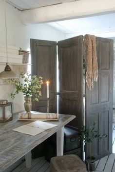 3 mismatched vintage doors, hinged to make a room divider/privacy screen.