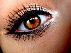 White eyeliner in the corner of the eye. LOVE.