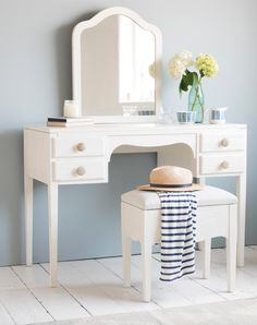 Loaf's white wooden dressing table with comfy padded stool, natural wooden handles and a mirror. Plus there are four lovely drawers for storing lotions and potions