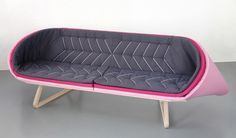 Sofa: by designer Antoinette Bader.  The three single foam mats covered with different colored textiles are connected to the wooden bench by a cord. The bent mats create the sofa's special shape and two cozy corners.