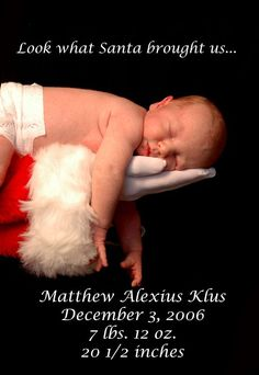 santa holding baby