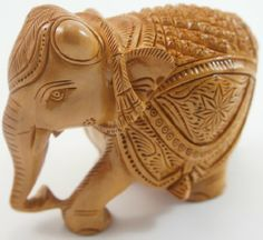Beautifully Handcarved Wooden Elephant The Modish Store, LLC,http://www.amazon.com/dp/B00AMMVQH2/ref=cm_sw_r_pi_dp_FvbMsb02J20TV8FK