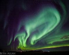 """""""The auroras outside of Edmonton were so bright that, for a while, it was easy to walk around in the field I was standing in,"""" says photographer Beth Allan"""