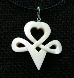 Celtic Bone Carved Pendant  Design: The Infinite Direction of the Heart  Bail: Sterling Silver Clip on Enhancer Bail  Necklace: Greek Leather (adjustable length)  Material: Buffalo Bone (Hand Carved)  Price: $40.00   This pendant is a limited edition design only ten ever made.   With an enhancer bail it is extremely versatile, it can be worn on any kind of necklace be it a strand of pearls, beads, leather or chain.   To see our other designs visit us at www.facebook.com/groups/MysticalSpirit
