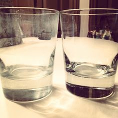 how to: get rid of hard water stains - vinegar in a glass on the bottom of dishwasher. Reuse same glass over an over