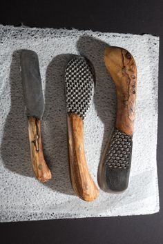 Chelsea Miller Knives - At once sensuous & solid, whimsical and practical, rough-hewn & precise, these beautiful knives & graters are the work of Chelsea Grace Miller, the daughter of a Vermont carpenter and blacksmith who grew up in her father's shop. Miller makes her blades out of repurposed, durable high-carbon steel horse files; her gorgeous handles are fashioned from maple & applewood found on the family's Northeast Kingdom property. The finished tools are just right for slicing…