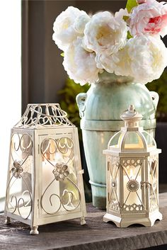 Talk about a romantic, candlelit evening. Pier Flower Pearl Scroll Lantern is the epitome of elegance, with a powder-coated iron frame, a hand-painted w. Romantic Bedrooms With Candles And Flowers Lanterns Decor, Candle Lanterns, Candleholders, Fire Candle, Lantern Candle Holders, Spring Home Decor, Spring Day, Wedding Decorations, Romantic Decorations