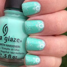 Snowflake moons - base is China Glaze Aquadelic. Coat of Finger Paints Motley which is a flakie iridescent 'snow like' coating in a blue/green - then tipped with a little sponged on silver glitter