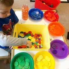 color sorting with Pete the Cat and a sensory bin filled with groovy buttons