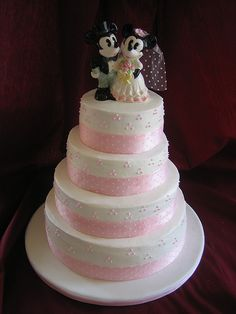 Four tier pink and white Disney Mickey and Minnie wedding cake