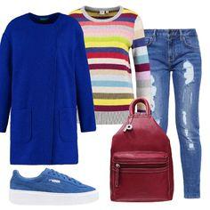 Il maglioncino di questo outfit con le sue righe colorate mette tanta allegria. L'abbinamento con jeans, cappotto e sneakers blu elettrico e zainetto bordeaux regala un look vivace e vitaminico.
