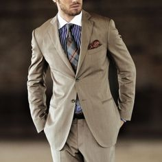 Tan colored suit with plaid tie
