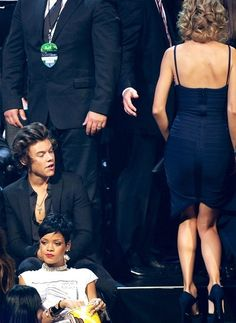 Harry checking out Taylor at the VMAs. Oh HAIL no. Son I will come after you.