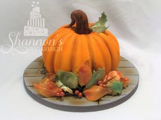 Fondant 3D pumpkin cake with autumn leaf detailing and airbrushing. Vanilla cake with vanilla buttercream. Keywords: Fall, Halloween. Design Credit: Mad House Bakes.