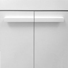 2 short cabinet handles combined for a long handle appearance giving it a stylish look. Designer Doorware product code 2481 in white satin finish.
