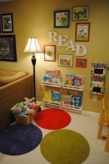 An adorable children's area with book shelves made out of spice racks, inexpensive rugs, and more! How cute!