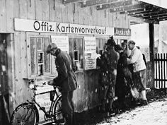 Spectators purchase tickets for the 1936 Winter Olympics in Garmisch-Partenkirchen, Germany. Norway was the overall winner, taking home seven golds, five silvers, and three bronze medals.