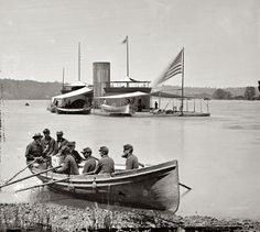 "1864. ""James River, Virginia. Double-turreted monitor U.S.S. Onondaga; soldiers in rowboat."" From photographs of the Federal Navy and seaborne expeditions against the Atlantic Coast of the Confederacy, 1861-1865."