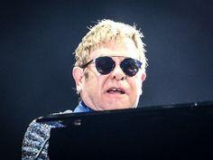 Elton John, with Dior Soreal Elton John Sunglasses, Ray Ban Sunglasses, Emporio Armani, Miu Miu, Oakley, Fendi, Prada, Dior, Rock In Rio
