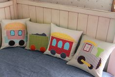 trains! Love the idea of doing a solid color bedspread that could grow with him but ancient pillows to make it younger looking and fun!!