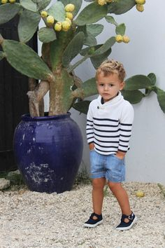 White and Navy striped cowl neck sweater paired with denim shorts