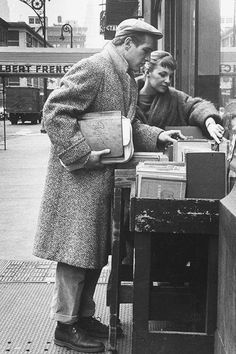 Paul Newman and Joanne Woodward shopping in Paris, 1959. Photograph by Gordon Parks.