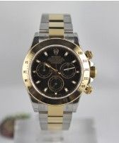 Rolex Cosmograph Daytona 116523    Year : 2012  Description : New, never worn. Compelto of box and Rolex warranty (24 months). Black dial.  Selling price : 9.450 €  List price : 12.610 €  Movement : Self winding  Case : Steel and Yellow Gold  Case number : N.D.  Dimensions : 40 mm  Dial : Black  Bracelet : Steel and Gold  Clasp : Déployante  Reference : 116523  Type : New