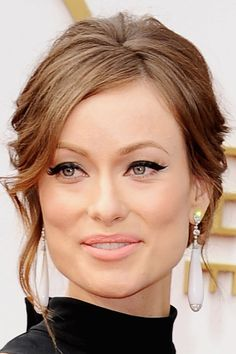 Punctuate a classic black cat eye by outlining the tip of the flick with an ultra-thin white line. It's unexpected and subtle on Olivia Wilde.