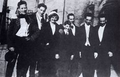 A rare photo of the entire Marx family circa 1915. Left to right: Groucho, Gummo, Minnie, Zeppo, Sam (Frenchie), Chico, Harpo. (from The Marx Brothers Scrapbook).  Sam and Minnie are the parents.