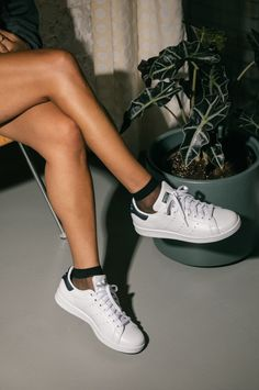 Women's adidas Stan Smith white sneakers are the perfect go-to for any outfit. Dress them up or dress them down. You can't go wrong with Stan.