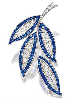 SAPPHIRE AND DIAMOND BROOCH, VAN CLEEF & ARPELS, NEW YORK.  Of foliage motif, the open work brooch set with calibré-cut sapphires and circular-cut diamonds together weighing approximately 8.00 and 2.00 carats respectively, mounted in platinum, signed and numbered N.Y.23816.