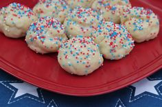 Italian Cookies      6 large eggs     5 cups flour     2 cups confectioner's sugar     2½ tablespoons baking powder     1 cup vegetable shortening     4 teaspoons lemon extract     grated lemon peel from one lemon  Glaze      3¾ cups confectioner's sugar (measure it, then strain it to get the lumps out)     ½ cup milk     2 teaspoons vanilla extract     2 oz. colored sprinkles
