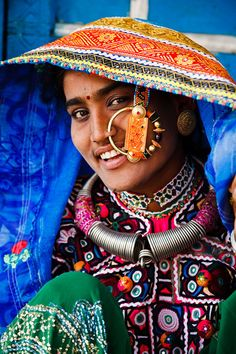 Portrait of a woman from the Marwada Meghwal Harijan tribe wearing traditional clothing and a large golden wedding ring through her nose in the village of Zura, located roughly 30km from Bhuj in the Kutch District.