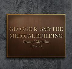 Plaques need not just be used for historical applications as in this example of a building designation. This bronze sign recognizes the contributions of an important individual and the building that got their namesake.