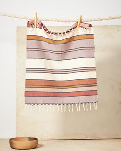 The Sunrise Stripe towels are a warm addition to any kitchen or bathroom. Woven by a man named Manuel in the village of Nahuala. Ethically made. Hand Towels, Tea Towels, Ceramic Incense Holder, Striped Towels, Gold Pillows, Eco Friendly House, Home Textile, Mother Day Gifts, Bathing