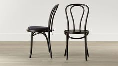 Shop Vienna Black Wood Dining Chair and Cushion.   This timeless, curvaceous classic is both incredibly strong and light, making it a popular choice for bistros.  A black lacquer finish gives it stylish versatility.