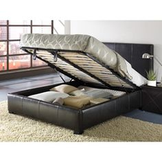 Add a contemporary, functional touch to your bedroom with this unique storage bed Bed is crafted of sturdy wood and metal European platform bed boasts a mattress support system Overall dimensions: 47