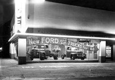 1948 Ford trucks in dealership showroom