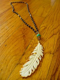 Feather carved bone - love the gold accent