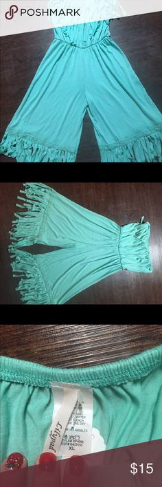 Lilypad boho chic romper. Boho chic romper. Sea foam green. Fringe detailing. New with tags. Size XL. 67% Polyester/ 30% Rayon/ 3% Spandex. Excellent condition. No trades. Thanks for looking! Lilypad Other
