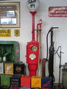 Petrol pump with other paraphenalia in Pallot's museum, Jersey.