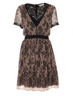 The ALICE by Temperley Judy Dress has a lace design printed onto a  silk georgette and is trimmed with contrast black lace. The v neck and  capped sleeve combined with a loosely fitting skirt make it an easy  piece to wear. Either dress up for evening or down for a sophisticated  day look. Looks good with a belt.